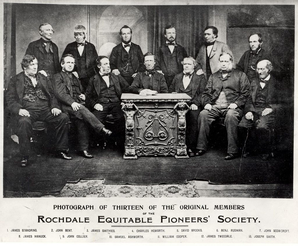 Photograph of the 13 original Rochdale Pioneers (all white men)